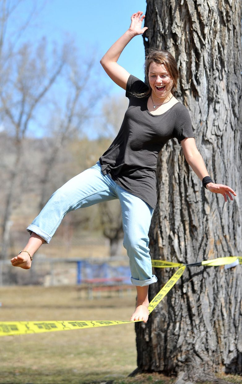 Sarah White and a few friends took some time at lunch Monday afternoon to enjoy the warm weather and work on slacklining at Little Toots Park.