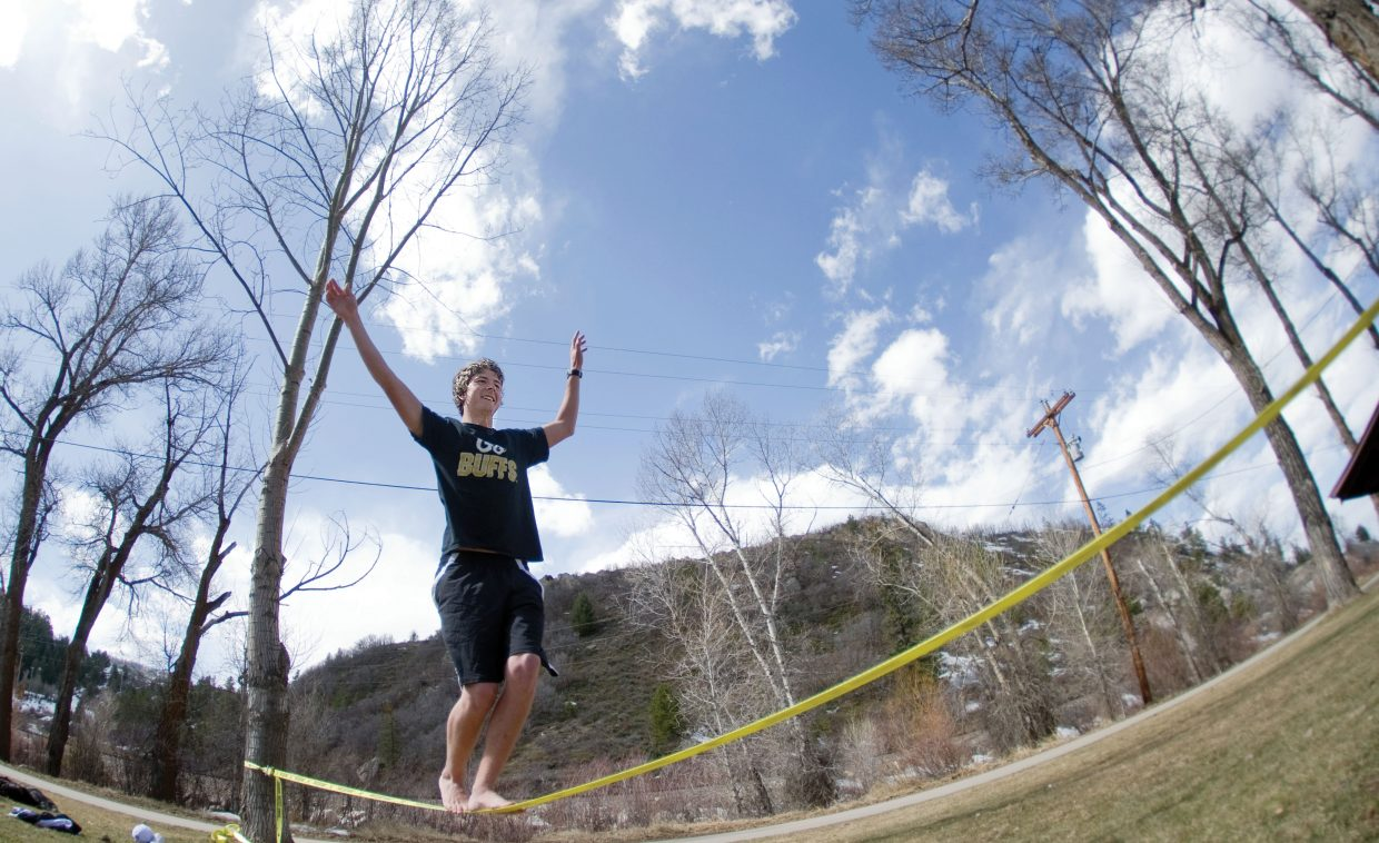 Ryan McMahon, and a few friends, took a few minutes at lunch Monday afternoon to enjoy the warm weather and work on slacklining at Little Toots Park.