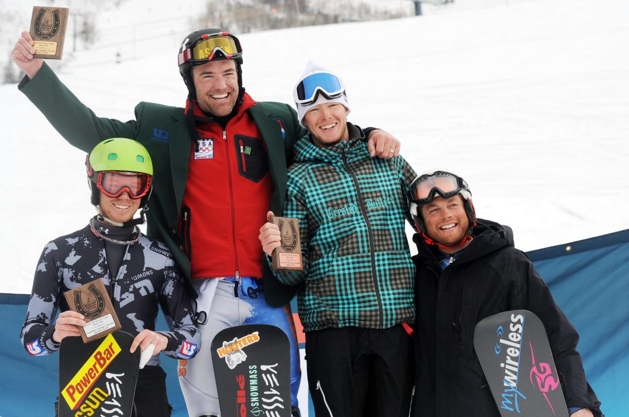 Michael Trapp, from left, Chris Klug, Justin Reister and Darren Ratcliffe celebrate on the podium after Saturday's NorAm snowboard parallel slalom finale at Steamboat Ski Area.