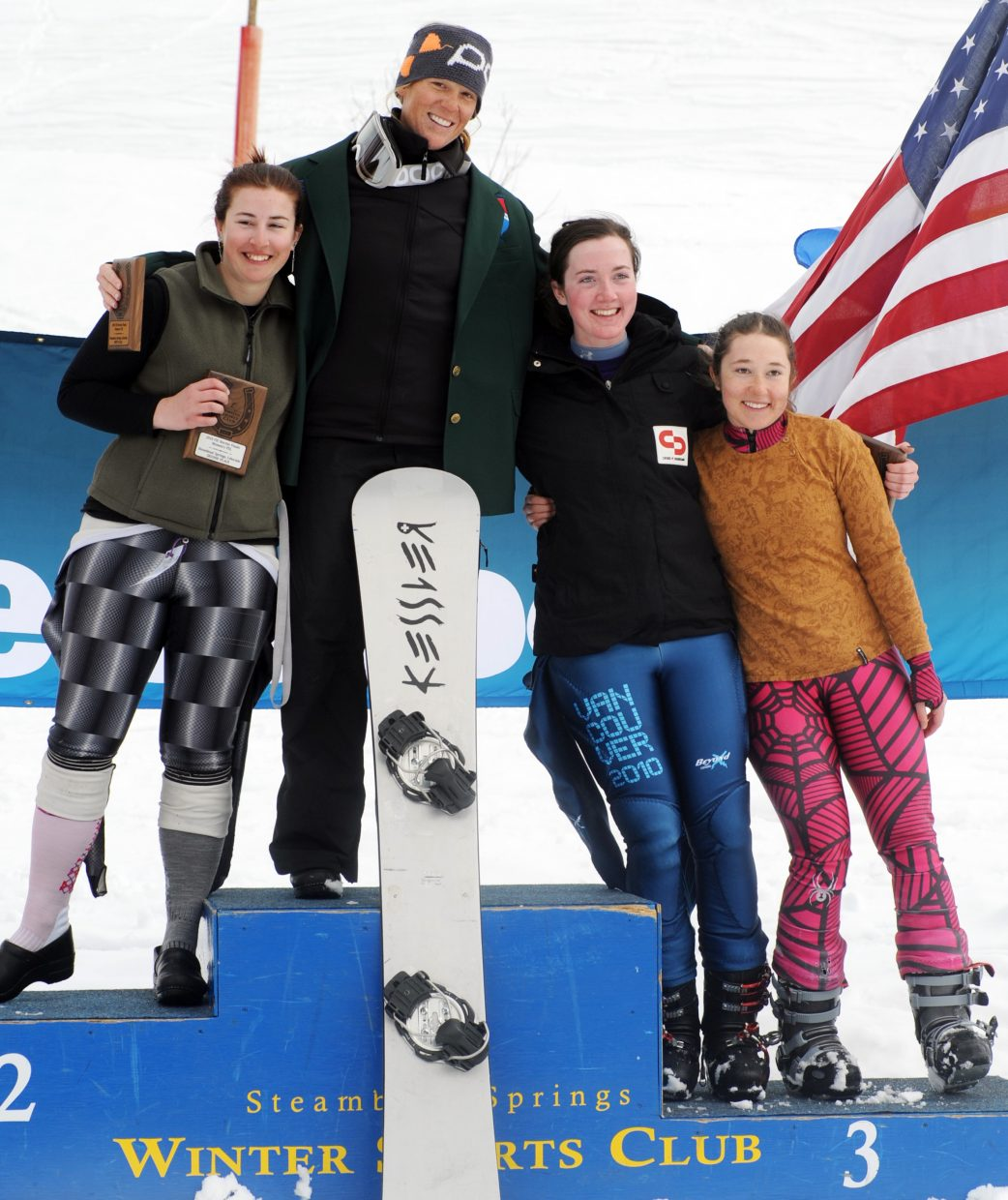 Heather Herde, left, Lindsay Lloyd, Megan Farrell and Casandra Wagar celebrate on the podium after Saturday's parallel slalom event at Steamboat Ski Area. Lloyd won, winning her second national championship in as many days and locking up the season-long NorAm points title.