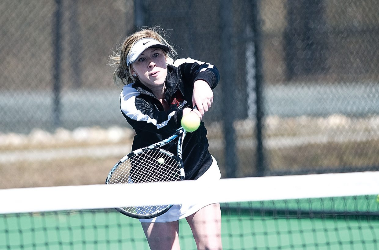 Steamboat Springs Sailor Katie Spencer returns a shot during a match against Vail Mountain School on Tuesday afternoon at the Tennis Center at Steamboat Springs. Spencer and partner Malia Fraioli won the match, 6-2, 6-0, and helped the Sailors roll to a 7-0 win against the visiting Gore Rangers.