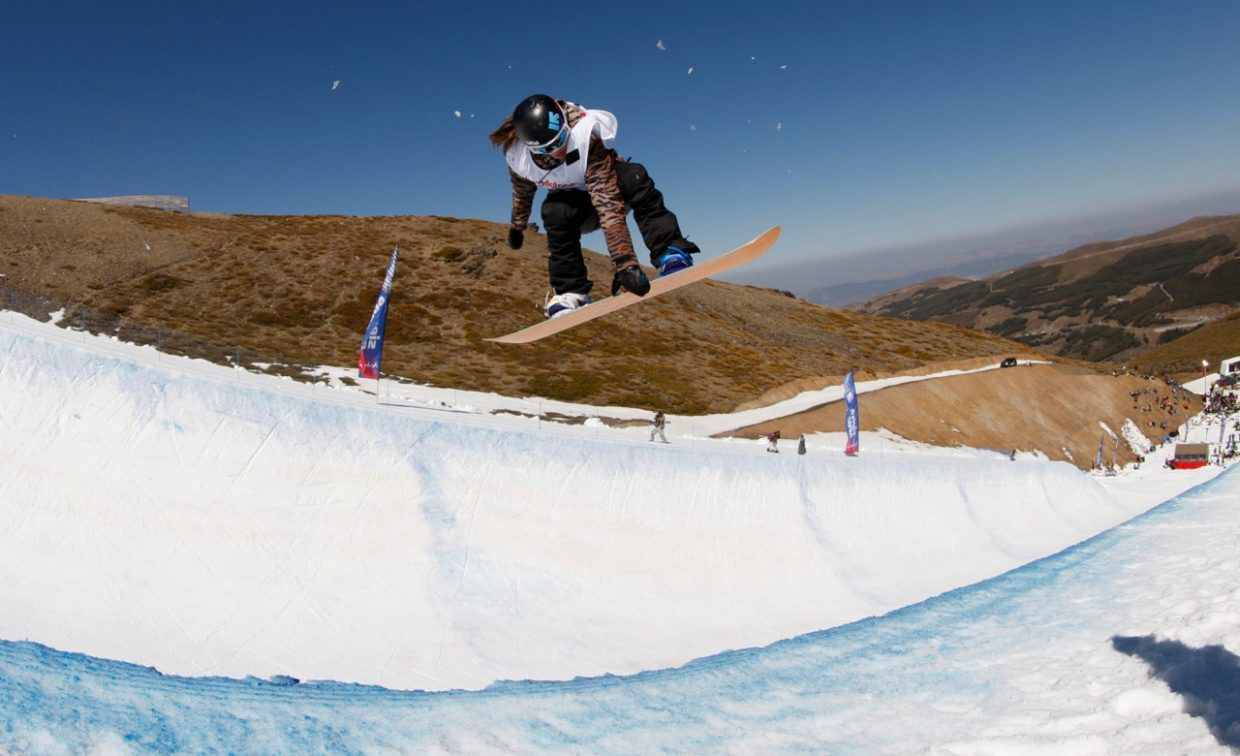 Steamboat Springs Winter Sports Club snowboarder Arielle Gold flies into the air on her way to winning the FIS Junior World Championship half-pipe event Tuesday in Sierra Nevada, Spain.