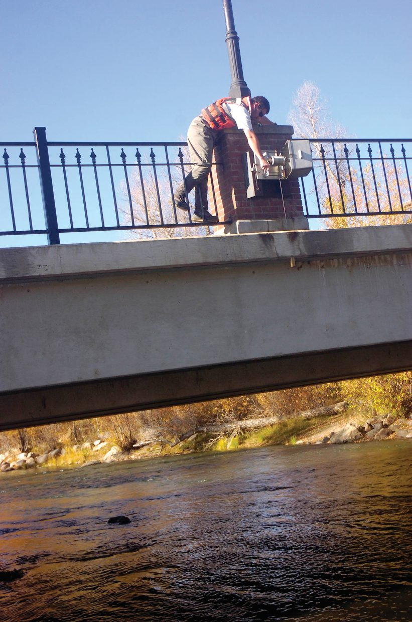 U.S. Geological Survey hydrologic technician Kevin Murphy measures the Yampa River gauge height in October 2008 at the measuring site located at the Fifth Street Bridge. The Routt County Board of Commissioners on Tuesday voted to expand the number of water-quality monitoring sites on the upper Yampa for 2012.