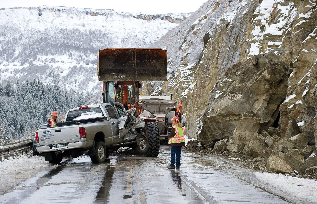 Colorado Department of Transportation removes a truck from the eastbound lane of U.S. Highway 40 after a rockslide Monday morning. The truck and a vehicle following it drove into the eastbound lane to avoid the slide but could not avoid the rocks.