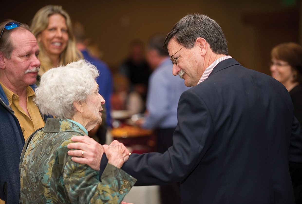 Yampa Valley Medical Center CEO Karl Gills visits with Bennie Goodman and her son John during a retirement party Thursday evening at The Steamboat Grand. Thursday's celebration was a chance for the community to come out and thank Gills for his 11 years leading the Routt County hospital and wish him a happy retirement.