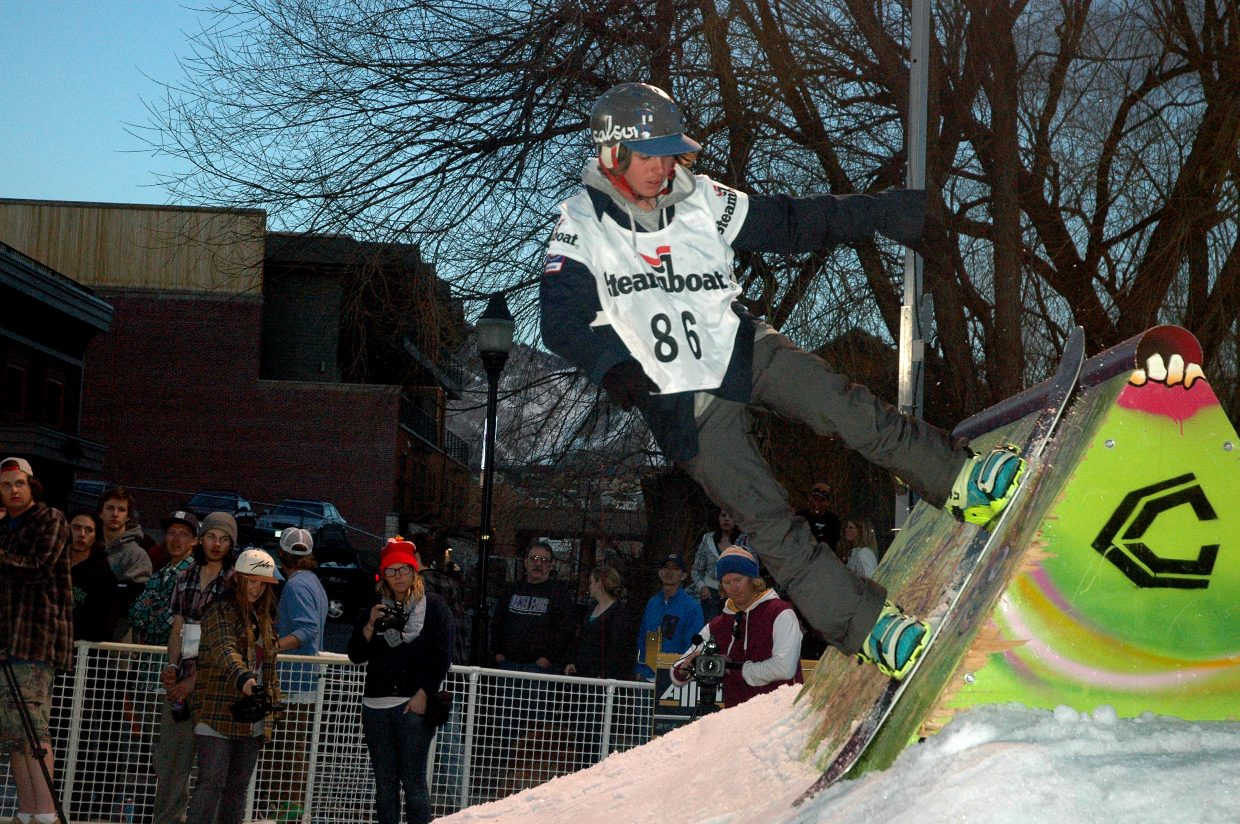 Snowboarder Josh Bosser competes in the finals of Urbane's Midtown Crisis Rail Jam.