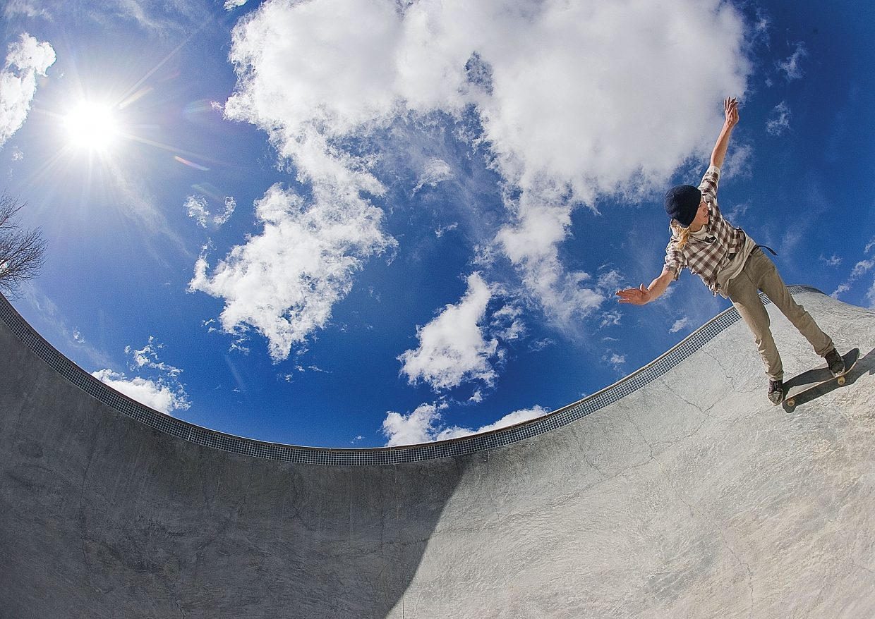 Skateboarder Teddy Dickson enjoys a warm spring day while riding at the Bear River Skatepark in Steamboat Springs. He said the concrete skatepark has been open for about two weeks, and he wanted to take advantage of Tuesday's nice weather to work on his skills.