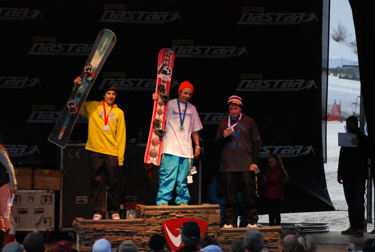 Steamboat Springs Winter Sports Club snowboarder Myles Silverman, center, celebrates after winning the boys 13 to 14 age group at the Nastar Nationals in Winter Park. Silverman is a freshman at The Lowell Whiteman School.