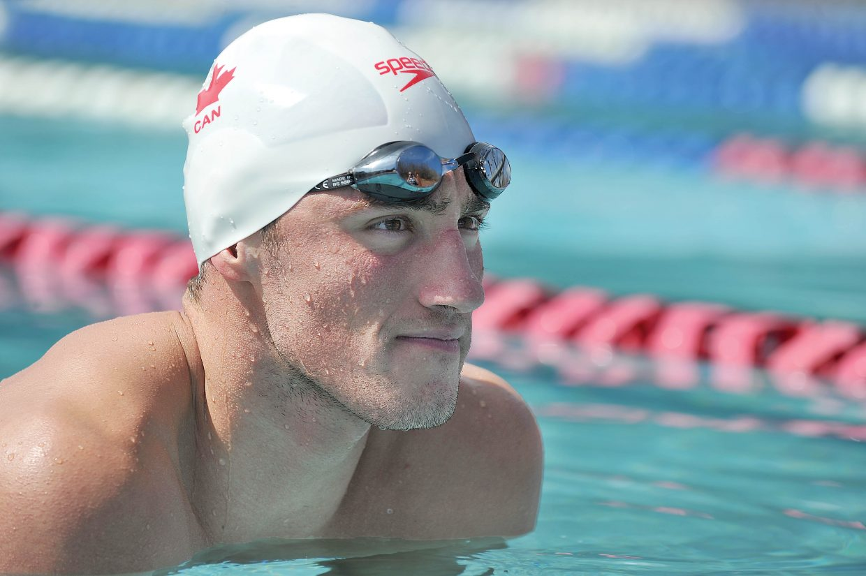 Swimmer Blake Worsley takes a break while swimming a few laps in the Old Town Hot Springs pool Wednesday afternoon. Worsley, who grew up in Steamboat Springs competing and training in the outdoor pool, will be representing Canada at this summer's Olympic Games in London.
