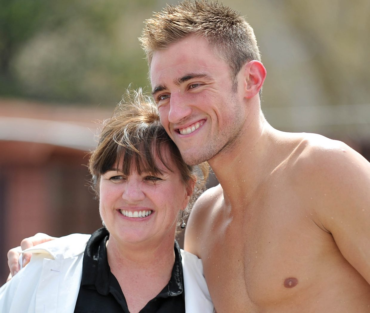 Swimmer Blake Worsley and his mom, Patti, pose for a photo at the Old Town Hot Springs pool Wednesday. Blake Worsley, who grew up in Steamboat Springs competing and training in the outdoor pool, will be representing Canada at this summer's Olympic Games in London.