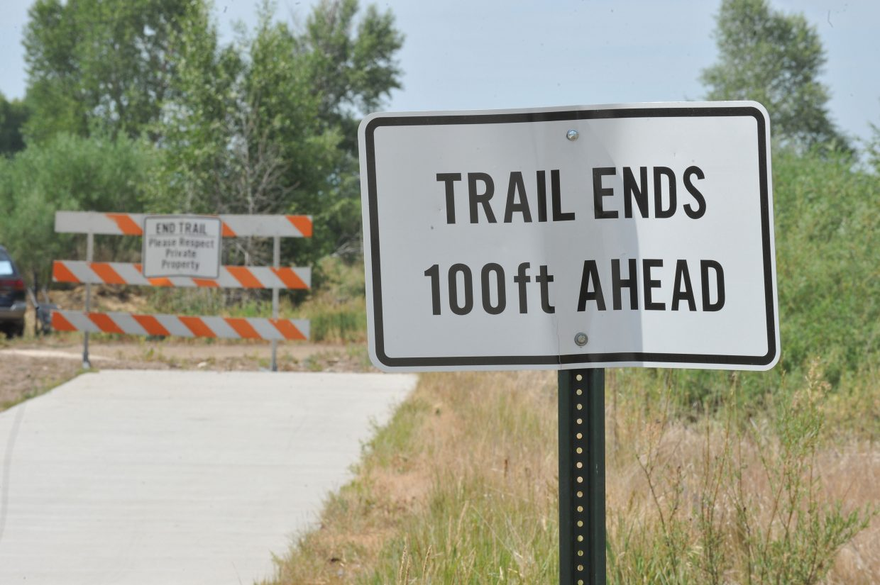 A sign marks the end of the Yampa River Core Trail west of Steamboat Springs near Minglewood Timber. The city is in negotiations with private landowners to secure permanent easements in hopes of landing a grant to extend the Core Trail on both sides of the city.