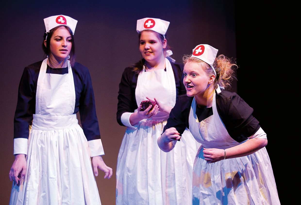 "Steamboat Springs senior Allie Hay plays the part of one of three witches during a rehearsal Tuesday for the high school's production of ""Macbeth."" Carly Hanley, far left, and Heather Seams, middle, play the parts of the other two witches."