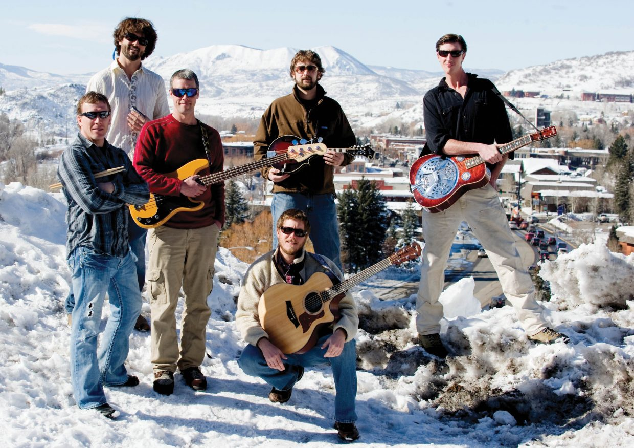 Missed the Boat band members, from left, Pat Waters, Peter Hall, Bryan Joyce, Andrew Henry, Ryan Cox (kneeling in front) and Jonathan Huge will play a show Saturday in Gondola Square, next week at Sweetwater Grill and on May 24 at Ghost Ranch.