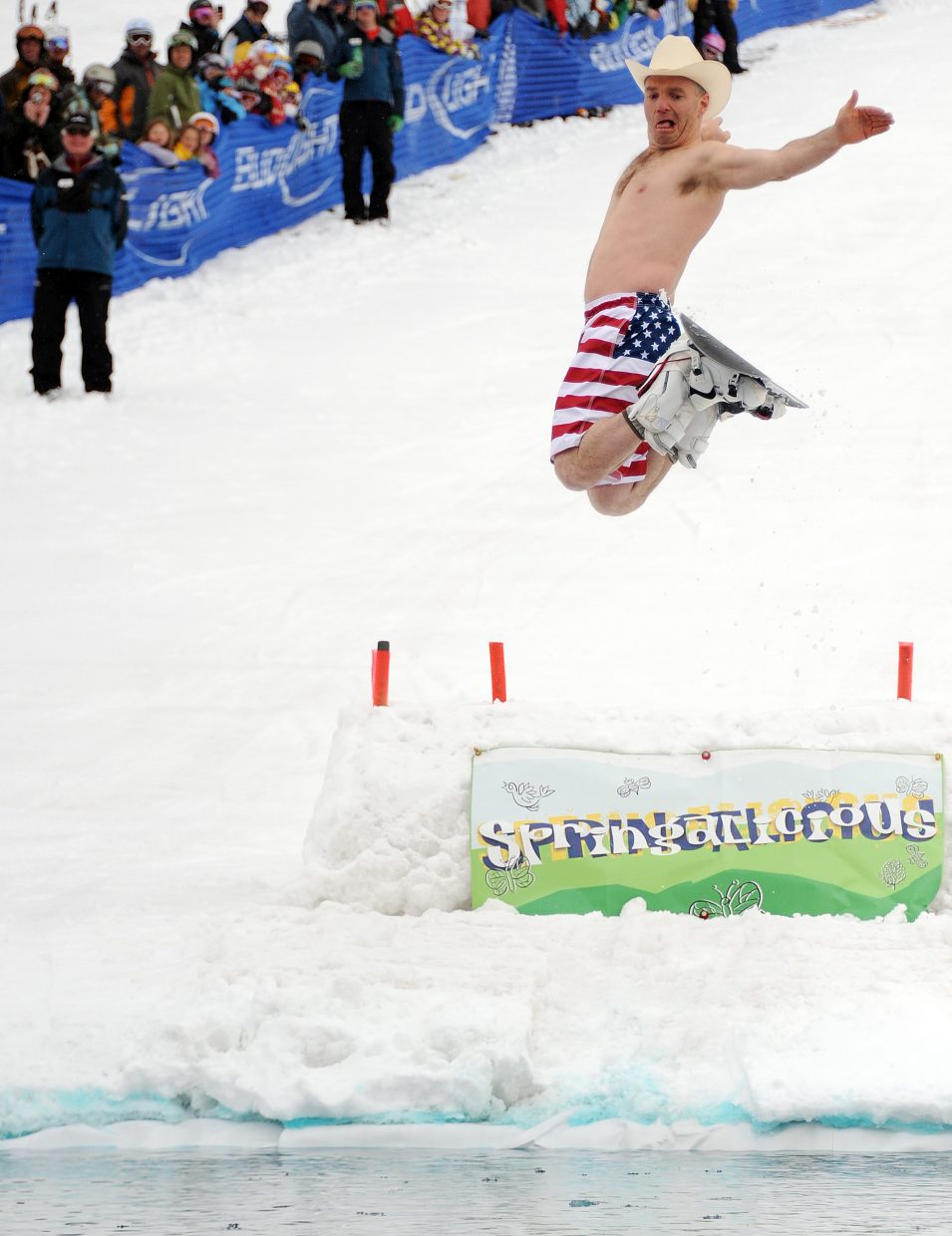 Ryan Speir flies off a kicker during Steamboat's Splashdown Pond skim competition that was part of the Closing Day festivities at Steamboat Ski Area.