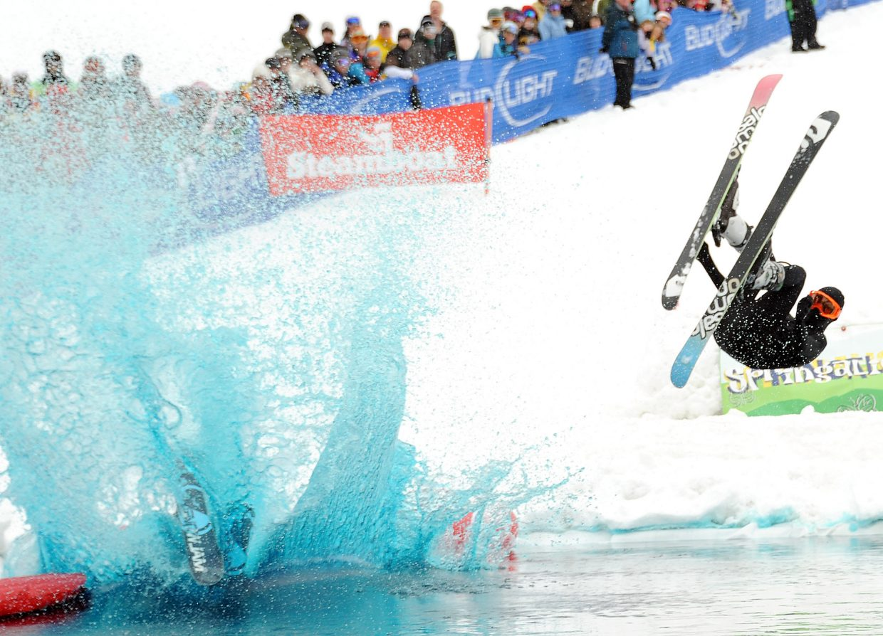 Cole Henry splashes down Sunday during the pond skim competition at Steamboat Ski Area.