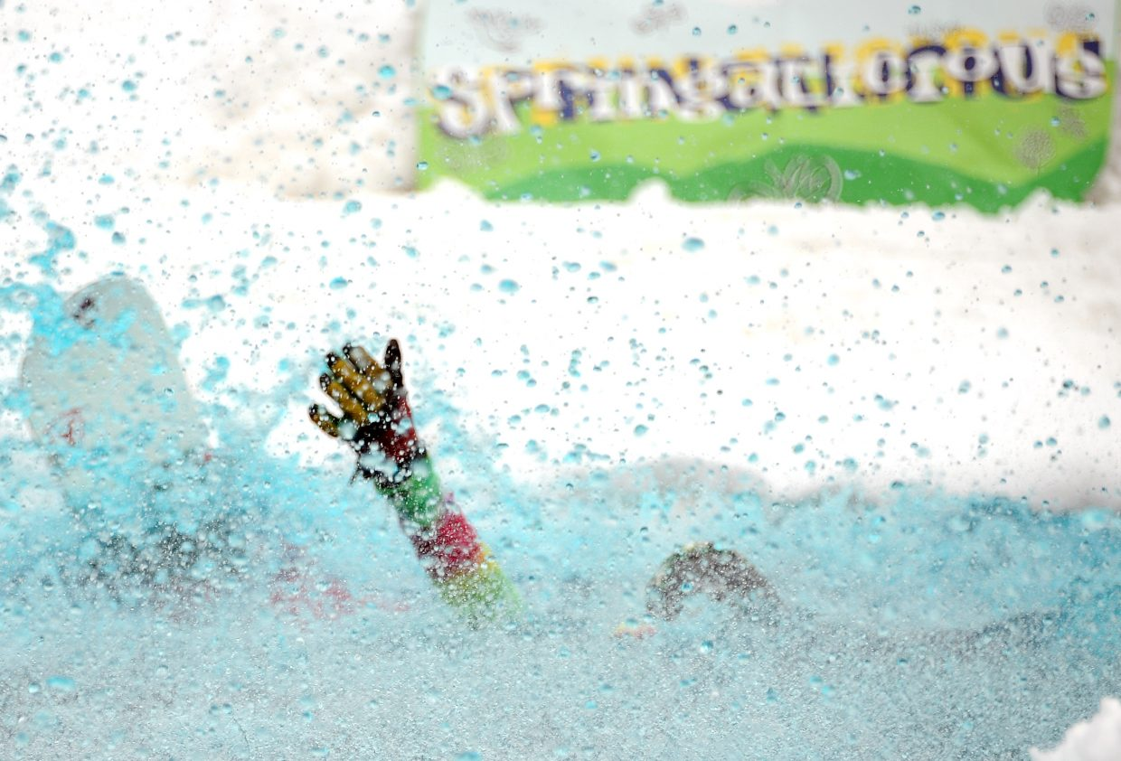 Kris Ratschkowsky slips under the water Sunday during the pond skim competition at Steamboat Ski Area.