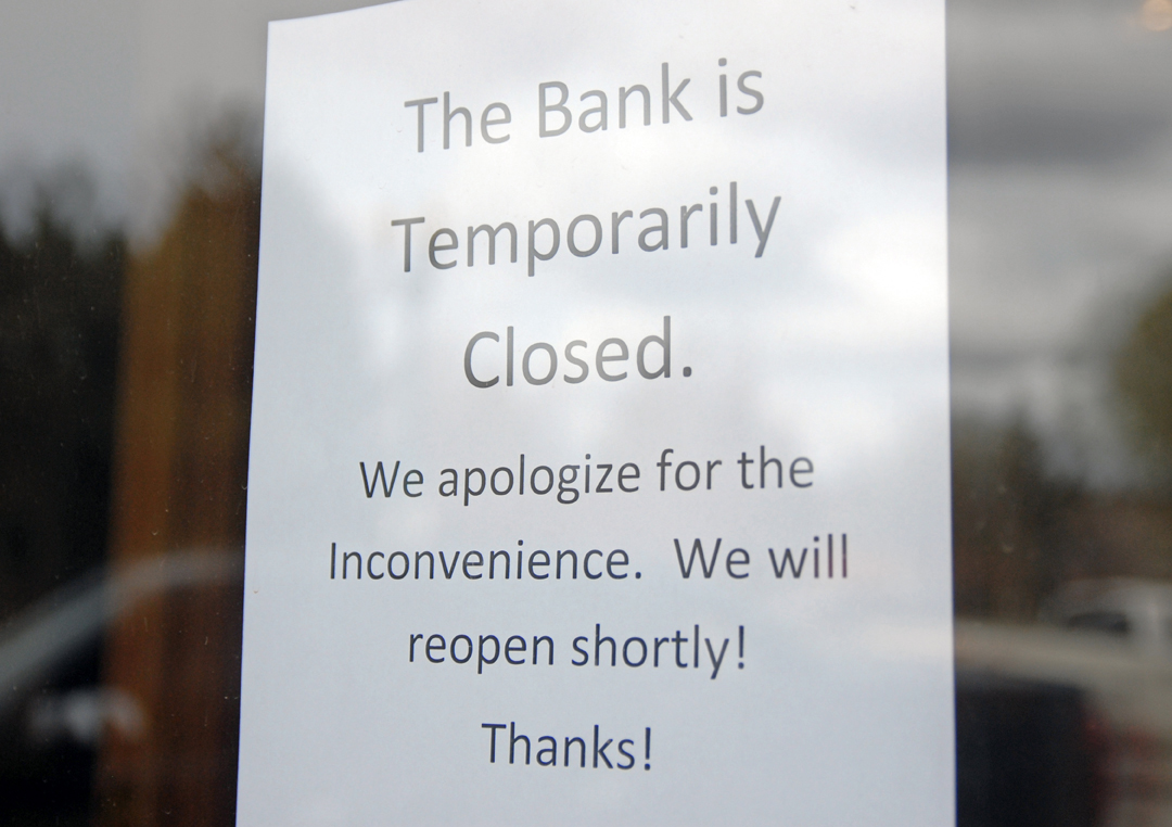 "A ""temporarily closed"" sign was taped Thursday to the front door window of Mountain Valley Bank in Meeker following a robbery."