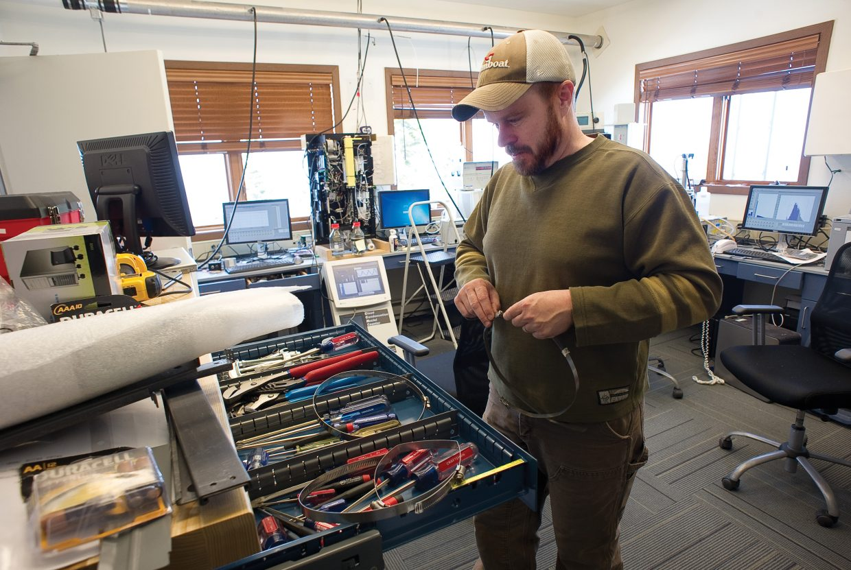 Scientist Ian McCubbin looks for the right tool to help set up new monitoring equipment that will measure mercury in the atmosphere at the Storm Peak Laboratory earlier this week. The Storm Peak Laboratory, which just underwent renovations, is a research center that integrates research and education by advancing the discovery and understanding within the field of aerosol and cloud interactions.