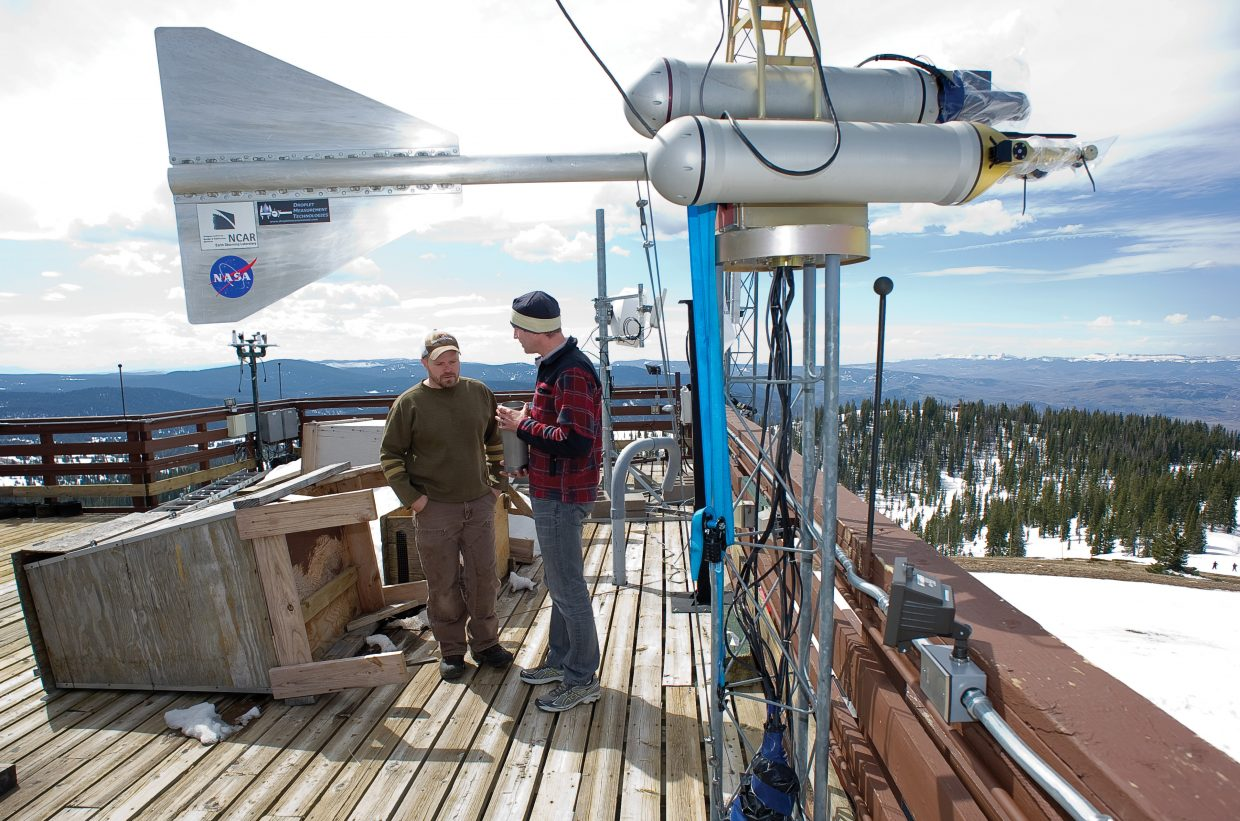 Scientists Ian McCubbin, left, and Daniel Obrist discuss the installation of equipment that will measure mercury in the atmosphere at the Storm Peak Laboratory earlier this week. The Storm Peak Laboratory, which just underwent renovations, is a research center that integrates research and education by advancing the discovery and understanding within the field of aerosol and cloud interactions.