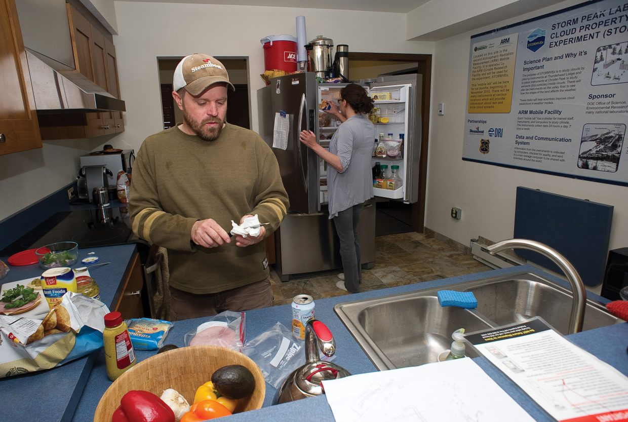 Ian McCubbin, front, and Gannet Hallar make lunch in the kitchen of the newly remodeled Storm Peak Laboratory at the top of Steamboat Ski Area. The Storm Peak Laboratory is a research center that integrates research and education by advancing the discovery and understanding within the field of aerosol and cloud interactions.
