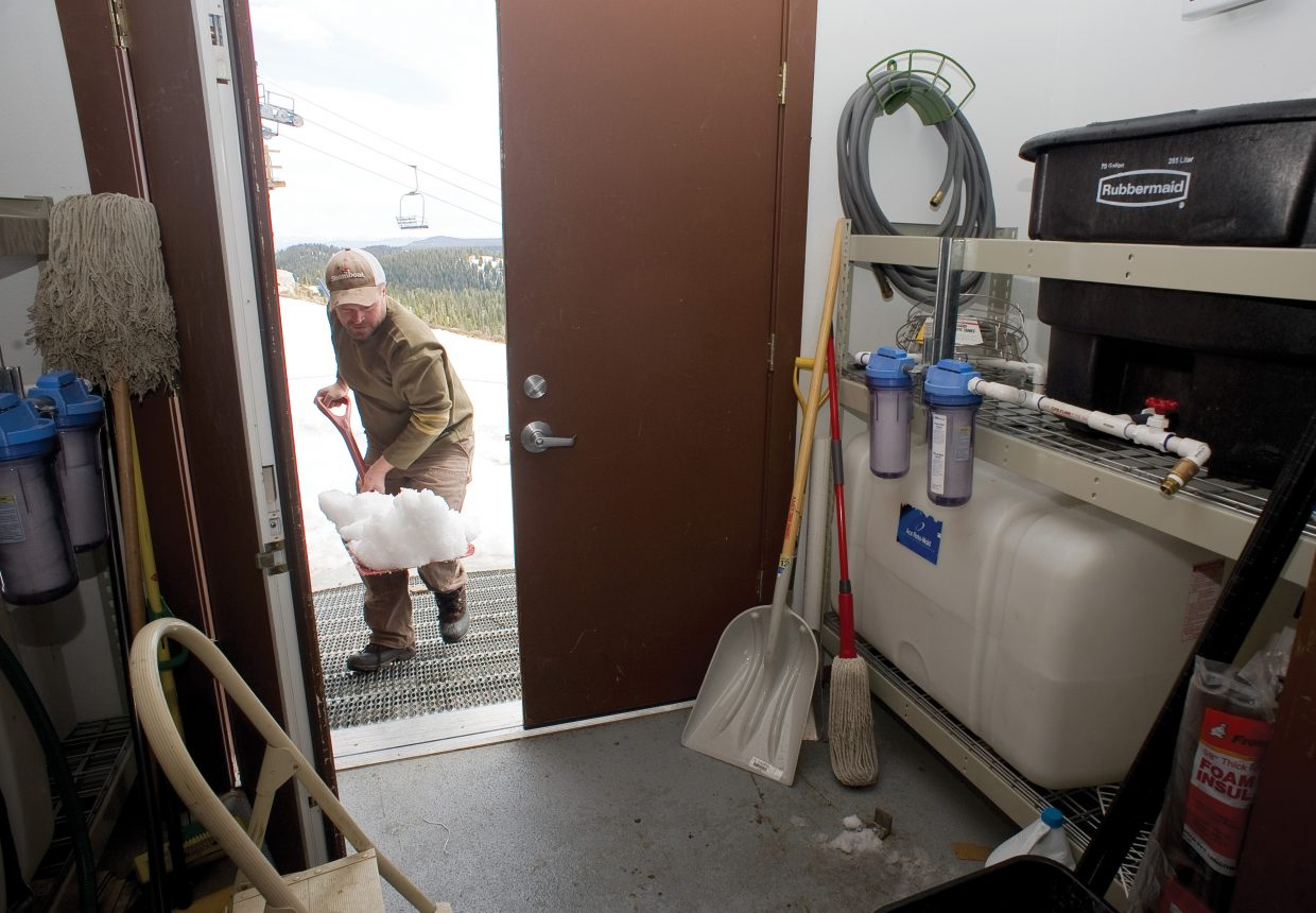 Ian McCubbin loads snow from outside the Storm Peak Laboratory located at the top of Steamboat Ski Area into tubs. The snow is melted into nonpotable water and is used for a number of different projects inside the on-mountain research facility.