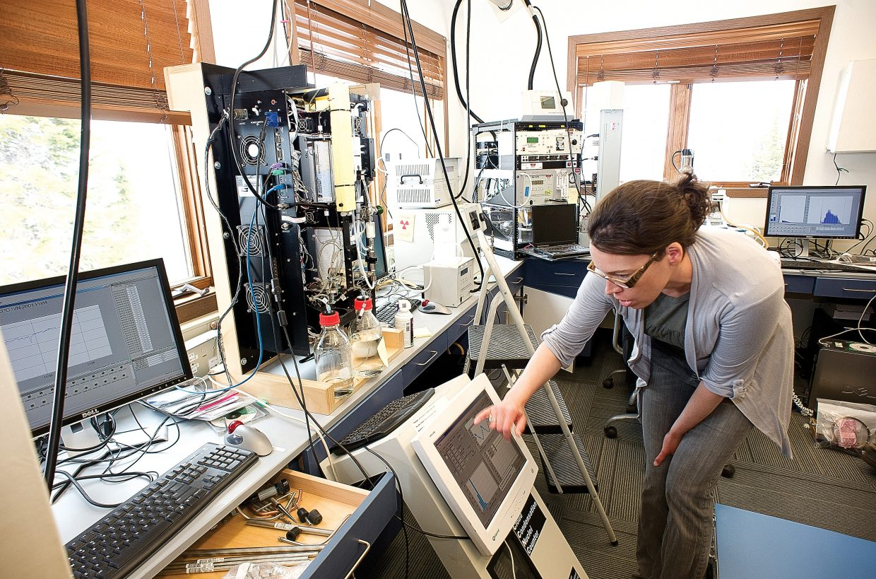 Gannet Hallar, assistant research professor and director of the Storm Peak Laboratory, checks equipment inside the research center located at the top of Steamboat Ski Area.