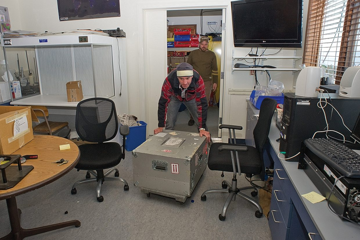Daniel Obrist, an associate professor at the Desert Research Center, unloads equipment used to monitor mercury in the atmosphere at the Storm Peak Laboratory.