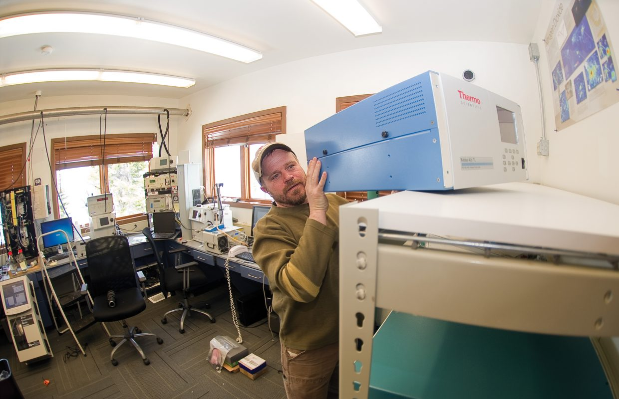 Scientist Ian McCubbin sets up new monitoring equipment that will measure mercury in the atmosphere at the Storm Peak Laboratory earlier this week. The Storm Peak Laboratory, which just underwent renovations, is a research center that integrates research and education by advancing the discovery and understanding within the field of aerosol and cloud interactions.