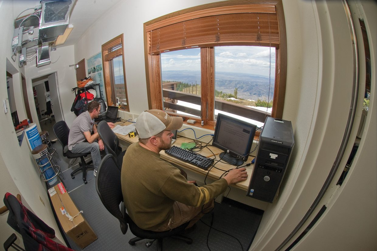 Scientists Ian McCubbin, left, and Daniel Obrist work to set up new monitoring equipment that will measure mercury in the atmosphere at the Storm Peak Laboratory earlier this week. The Storm Peak Laboratory, which just underwent renovations, is a research center that integrates research and education by advancing the discovery and understanding within the field of aerosol and cloud interactions.