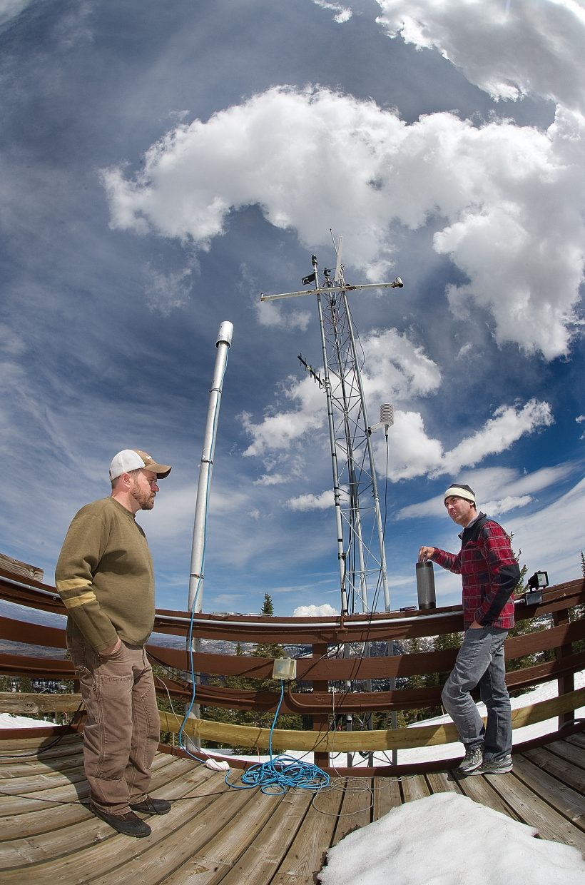 Research scientist and site manager Ian McCubbin and Daniel Obrist, an associate professor at the Desert Research Center, talk about how to set up equipment used to monitor mercury in the atmosphere at the Storm Peak Laboratory near the top of the Morningside lift at Steamboat Ski Area. The Storm Peak Laboratory is a research center that integrates research and education by advancing the discovery and understanding within the field of aerosol and cloud interactions. The permanent mountaintop facility, which was constructed during summer 1995 and has been in existence in various forms for more than 25 years, was remodeled during the past year, increasing its ability to study the Earth's atmosphere.