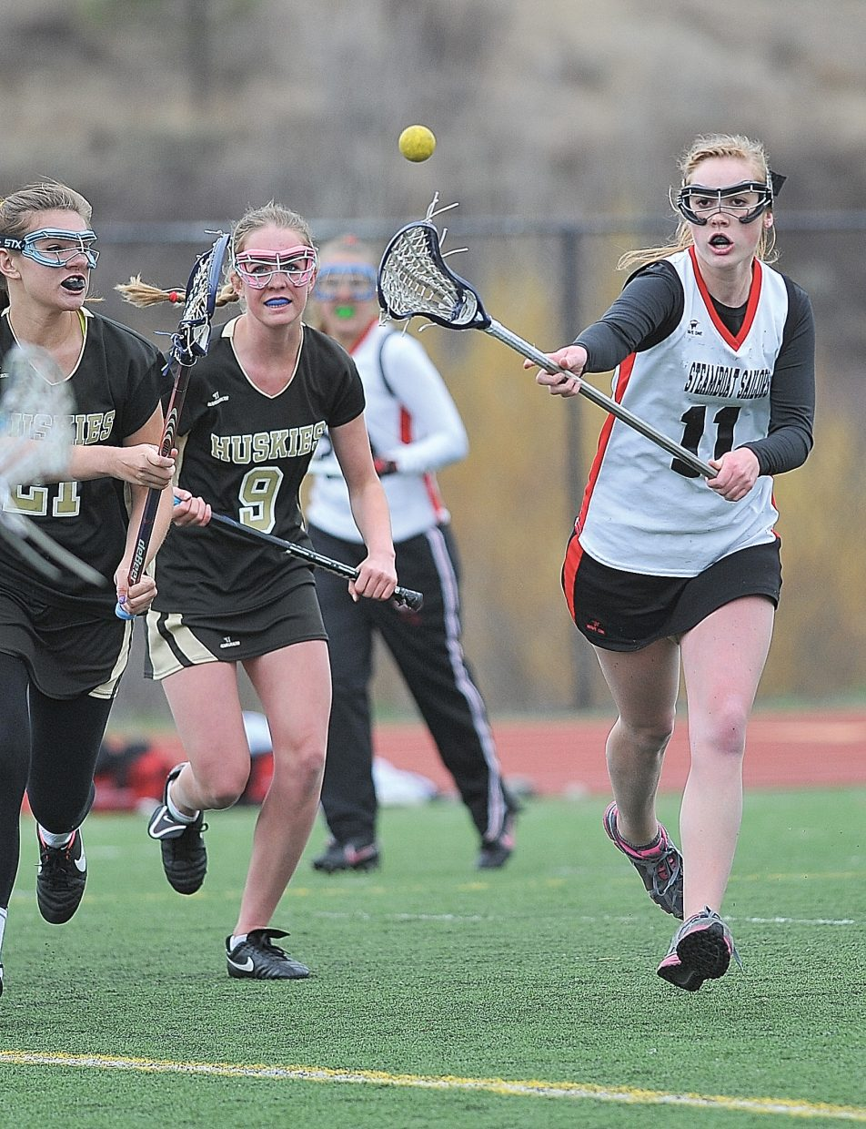 Steamboat Springs junior Emily Spiess passes the ball to a teammate during Friday afternoon's game against the Battle Mountain Huskies at Gardner Field. Battle Mountain won, 12-4.