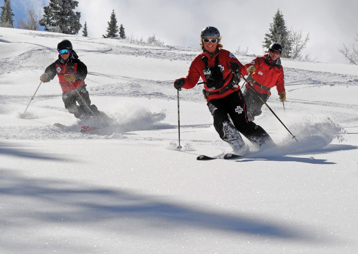 Steamboat ski patrollers Eric Besselman, from left, Michele Baxter and Johnny Sawyer sample some of the new powder on Norther on Friday morning at Steamboat Ski Area. More snow is expected to fall this weekend.