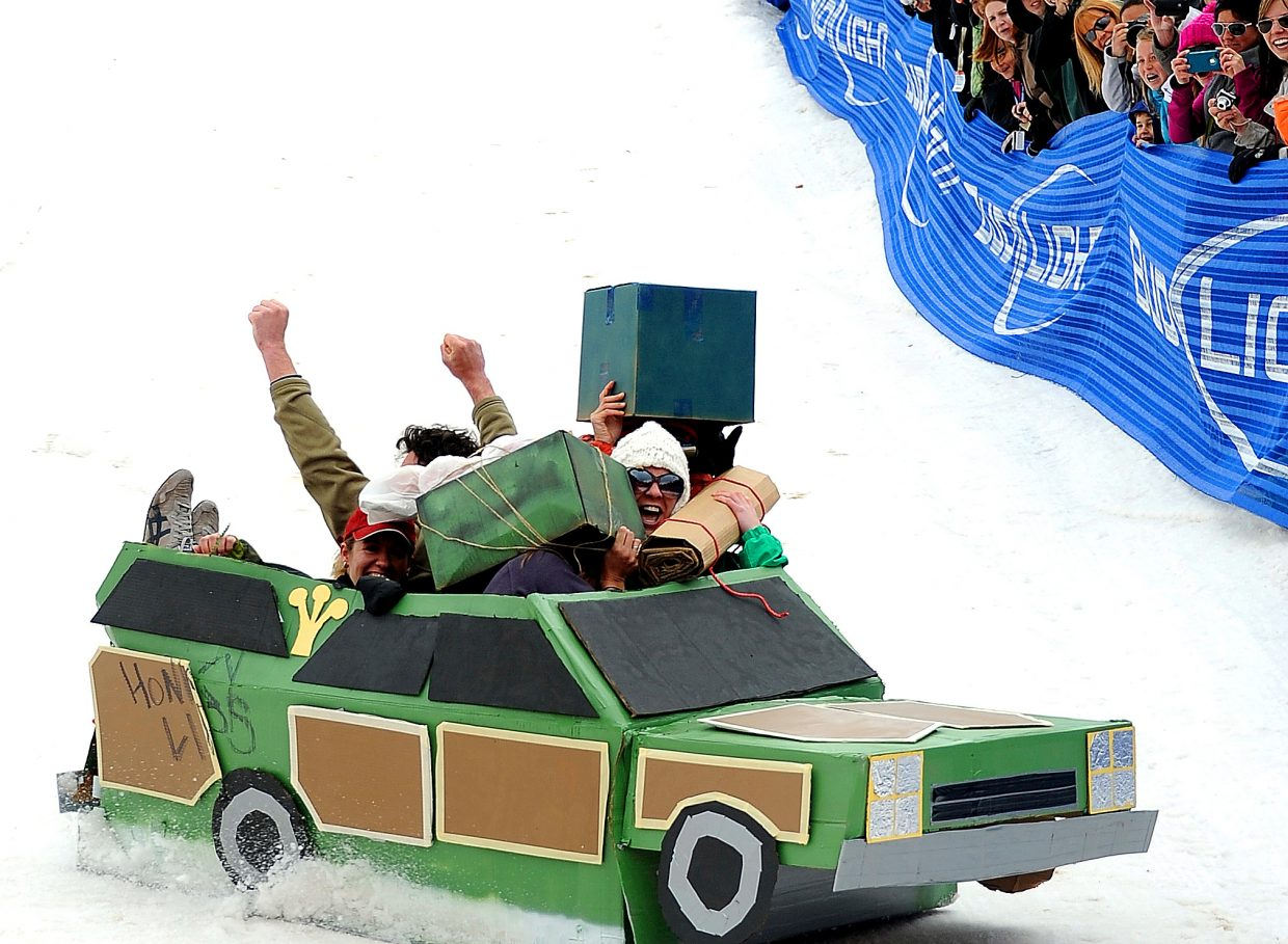 The Griswolds from the National Lampoon movies series fly down the Cardboard Classic run and brace for impact with the cushions at the end in their station wagon. Darcie Scheuring, right in white hat, was joined by Tony Scheuring, Regina Scheuring, Hilary Stojak, Katrin Iken and Mike Nagao in the wild ride.
