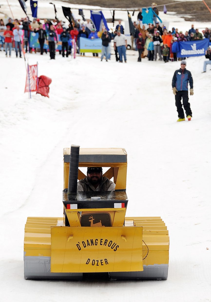 Dan Barrone plows down the course on his bulldozer at the Cardboard Classic in Steamboat Springs.