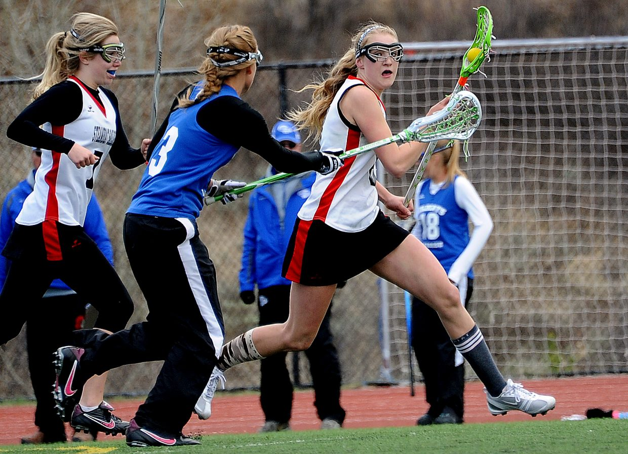 Steamboat's Teagann Yeager looks to cut through the Fruita-Monument defense Saturday.