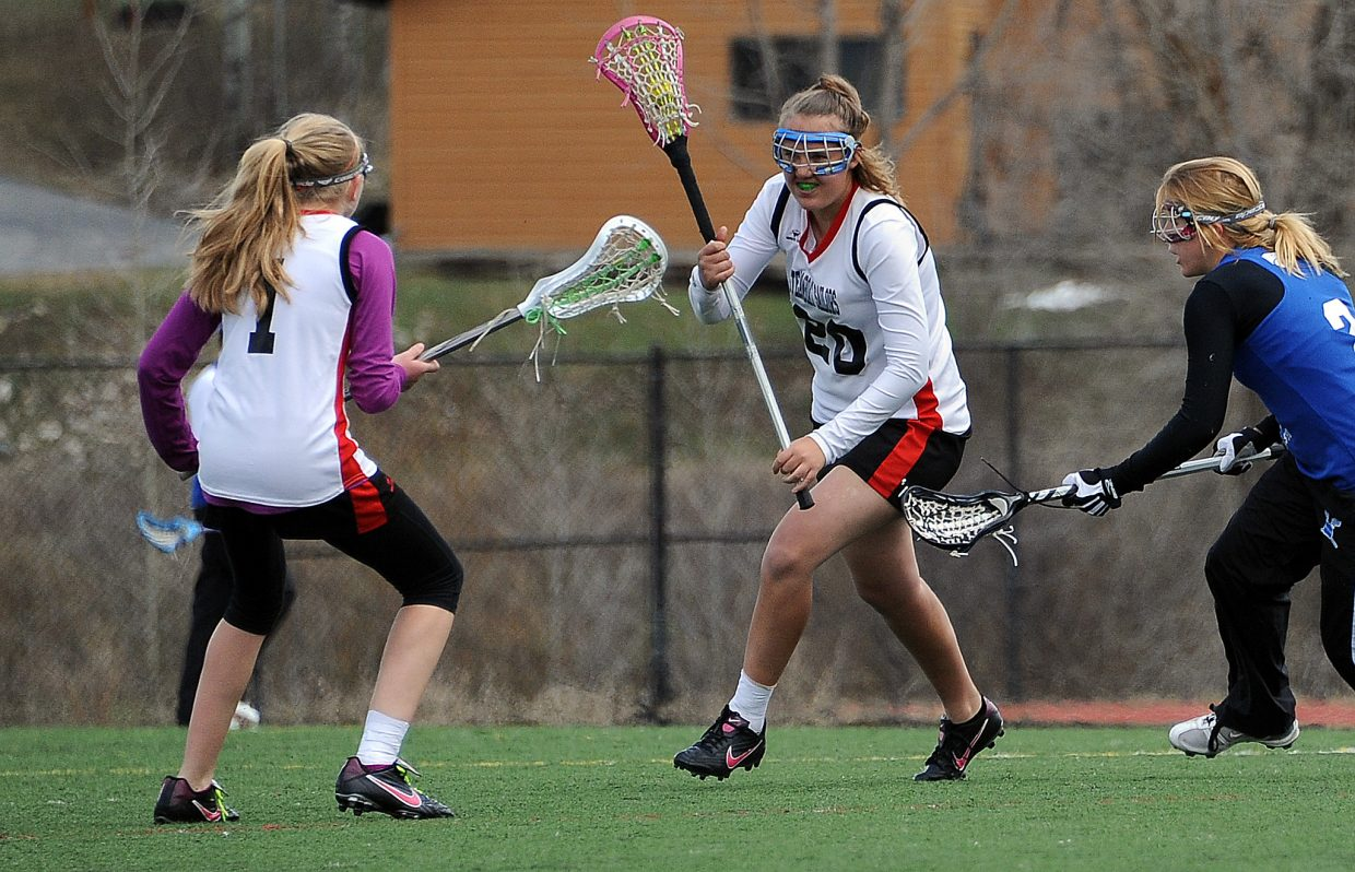 Steamboat's Courtney Reynolds advanced up the field with the ball Saturday.