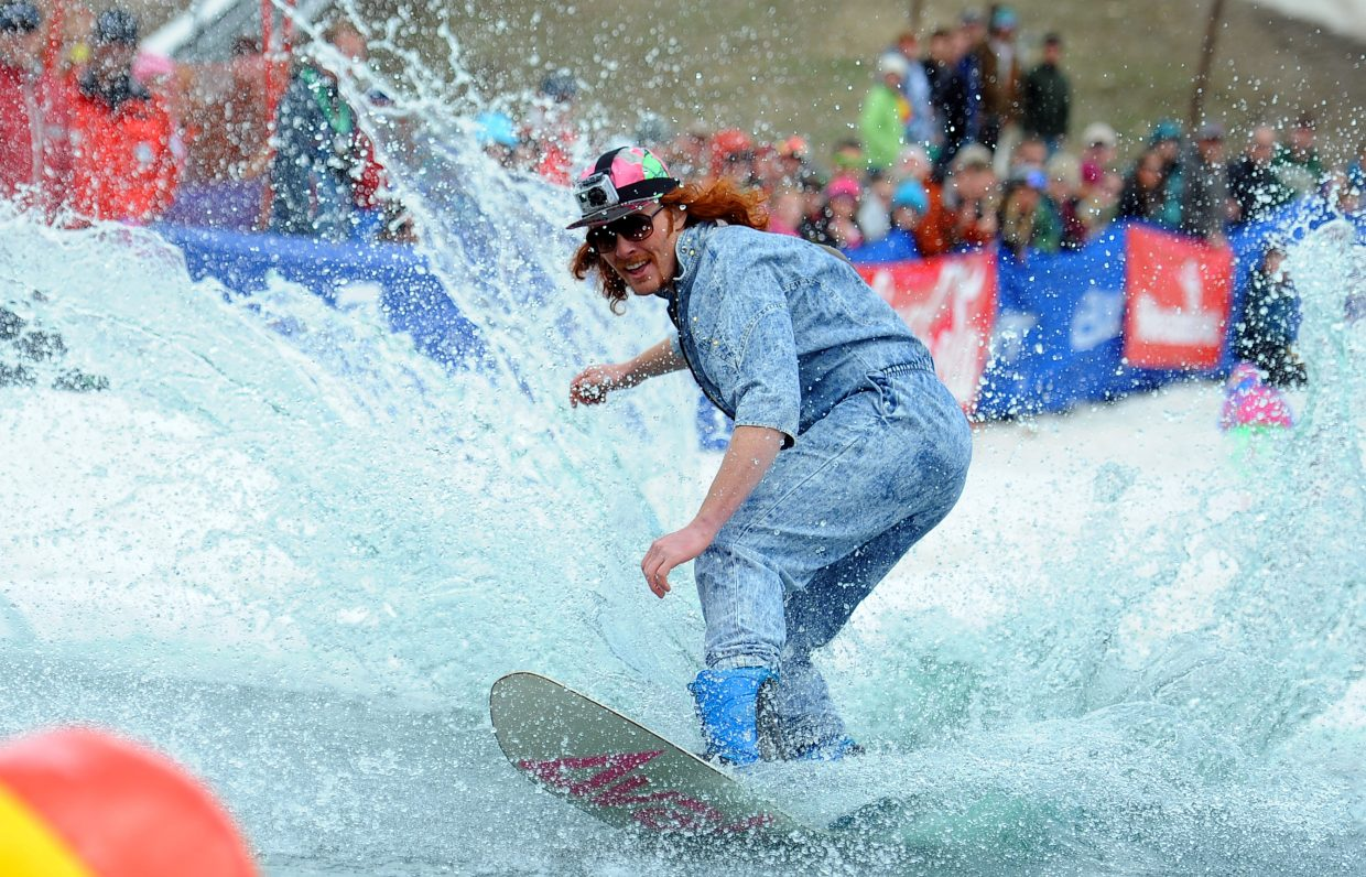 A snowboarder carves up the water Sunday at the Splashdown Pond Skim in Steamboat Springs.