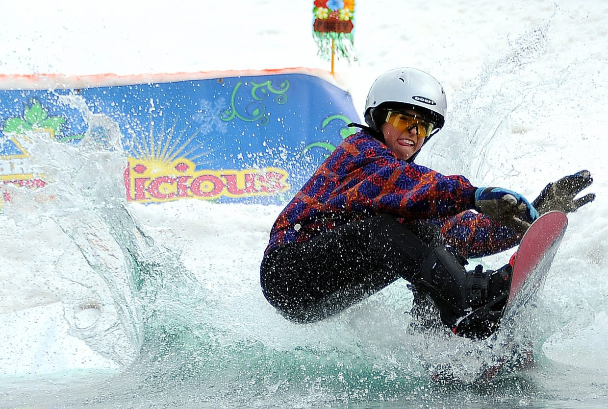 Billy Winters loses his footing on the pond at the Splashdown Pond Skim at Steamboat Ski Area.