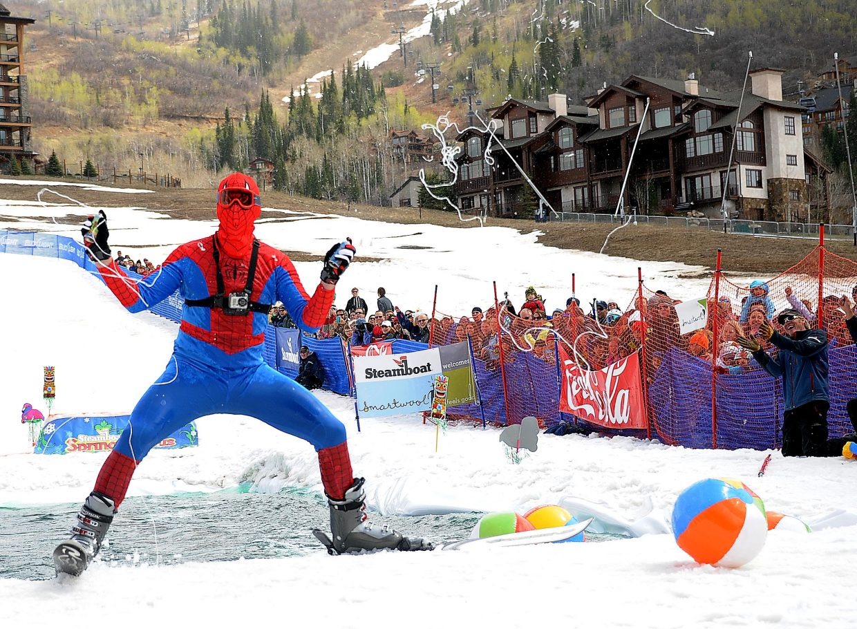 Phil McCoy celebrates a successful pond crossing by spraying some web Sunday at the Splashdown Pond Skim at Steamboat Ski Area.