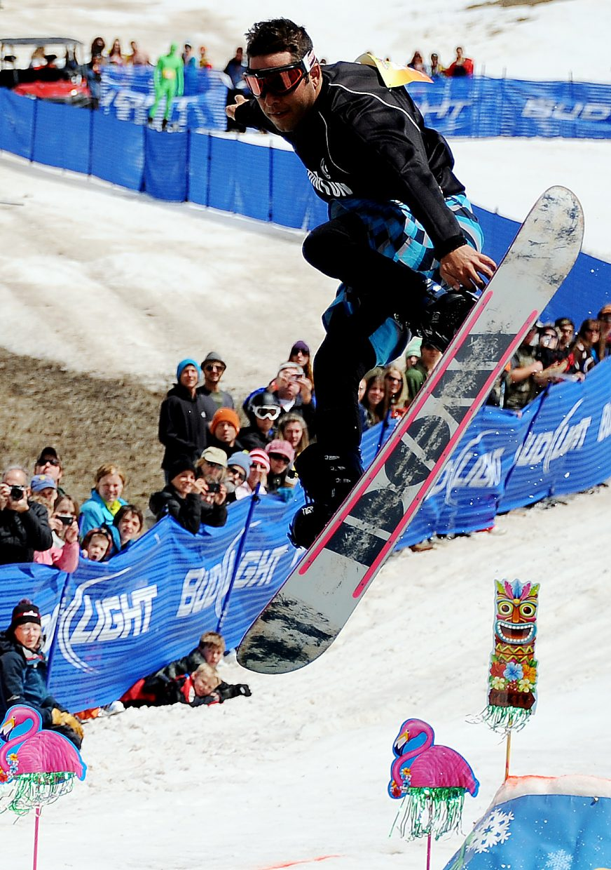 A snowboarder flies over the water Sunday at the Splashdown Pond Skim at Steamboat Ski Area.