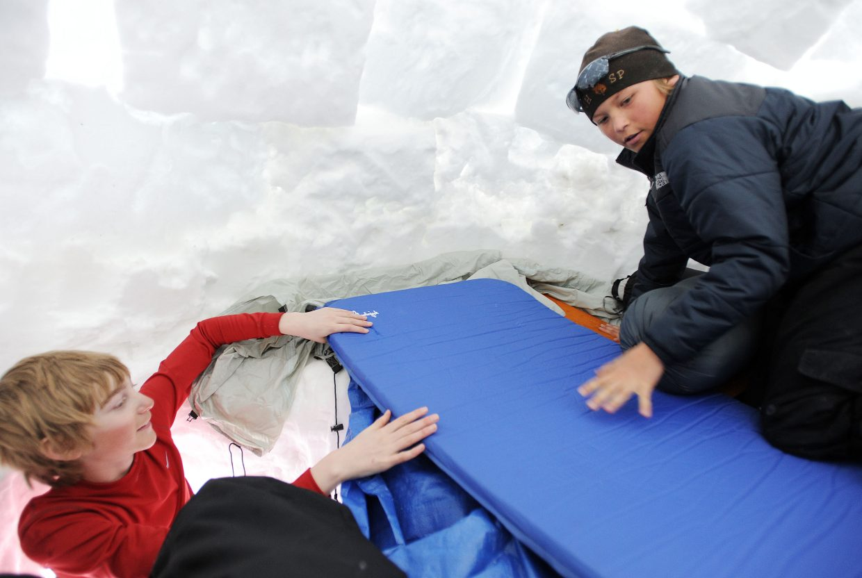 Aaron Vandergraaff, left, and Spencer Petersen lay out their bedding in an igloo last weekend during an Everything Outdoor Steamboat camping trip to Rabbit Ears Pass.