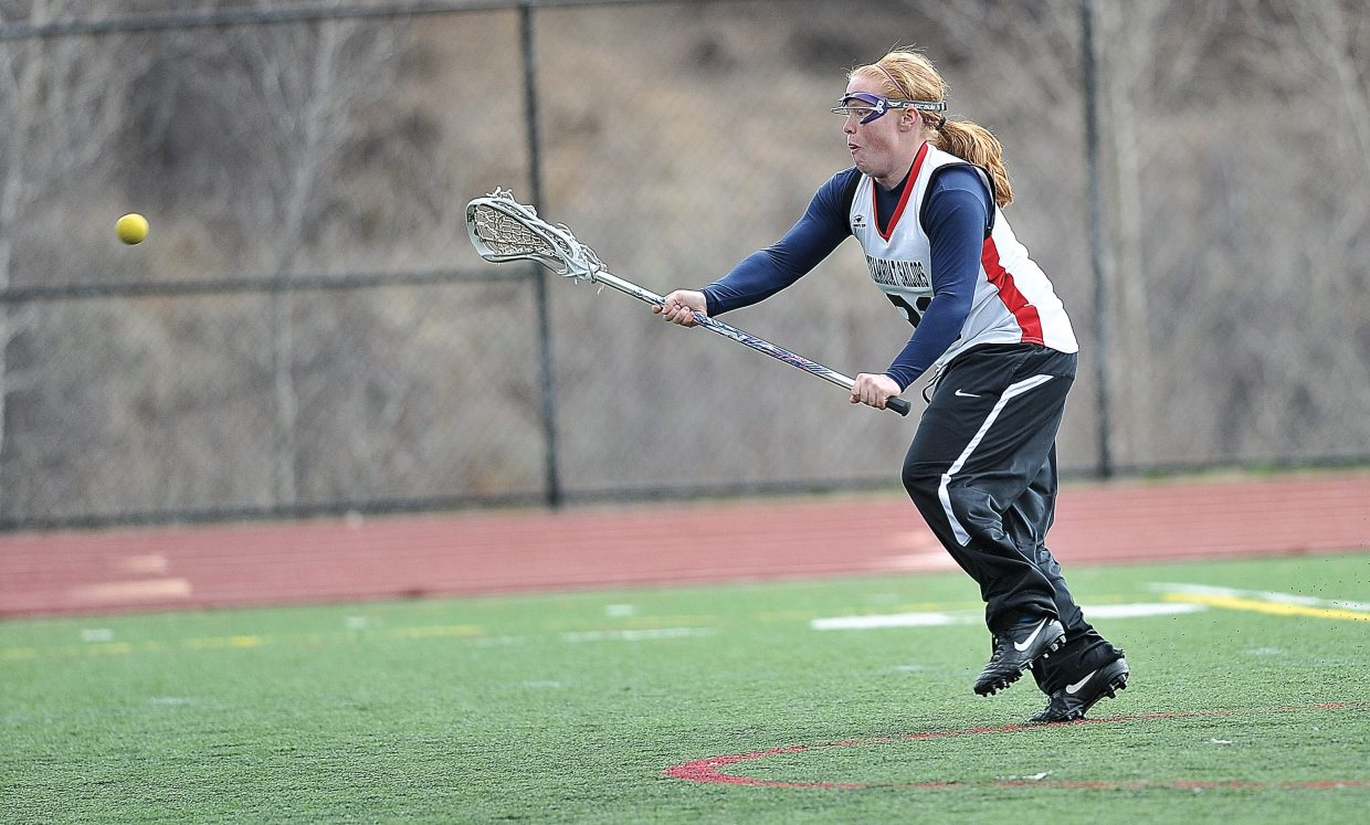 Steamboat Springs' Hannah Samlowski scores during the first half of Tuesday night's girls lacrosse game at Gardner Field.