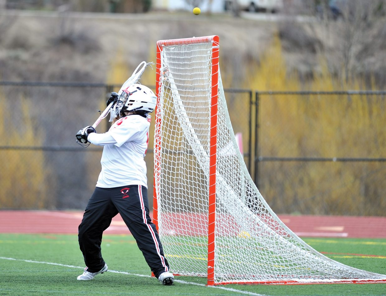 Steamboat Springs goalkeeper Sara Pugh deflects a shot over the net during Tuesday night's girls lacrosse game at Gardner Field.