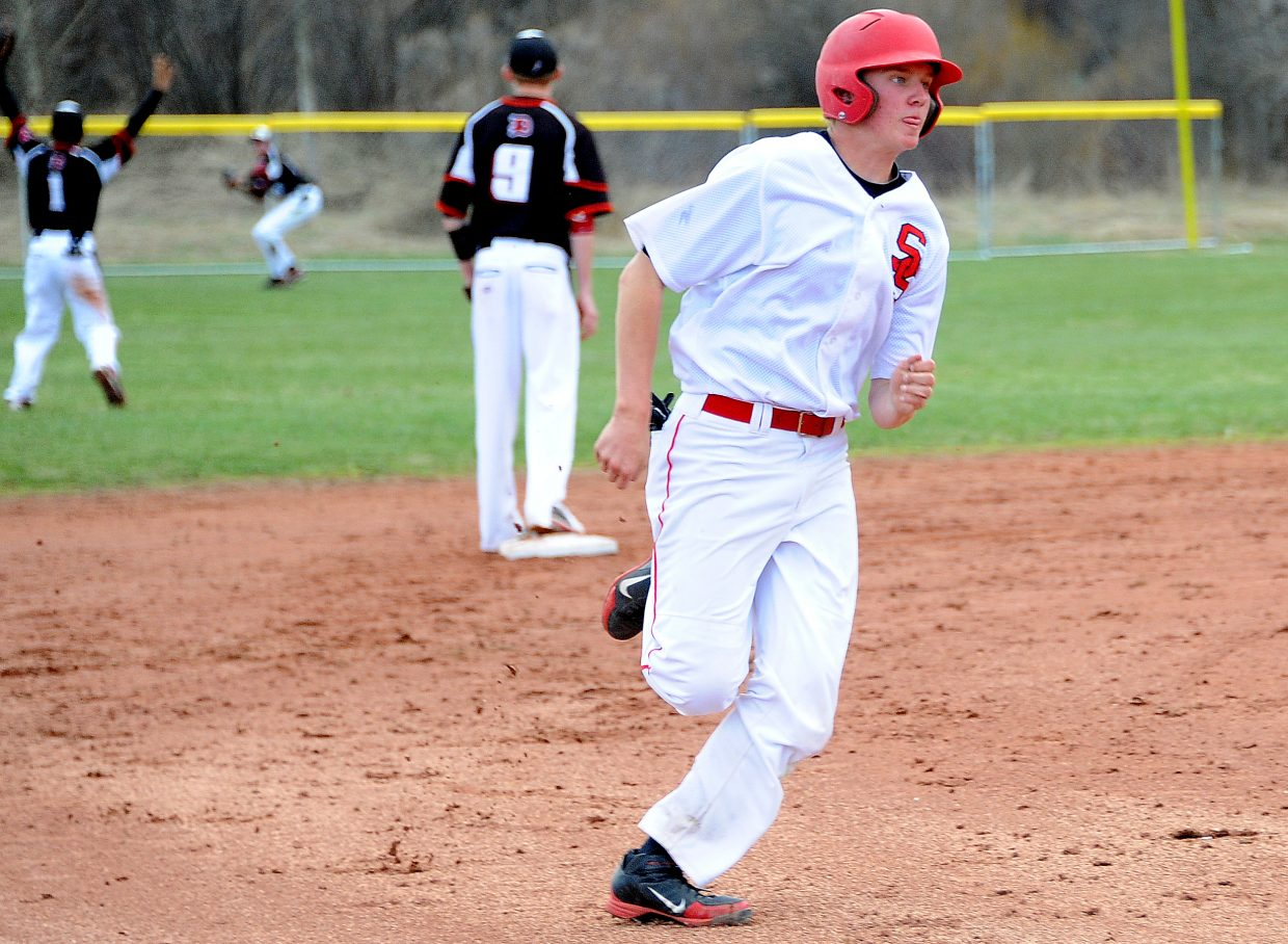 Steamboat's Thomas Kelly hustles toward third base Saturday, heading home on a two-run Cutter Pasternak triple. The Sailors won both games of a doubleheader against Eagle Valley, 6-3.
