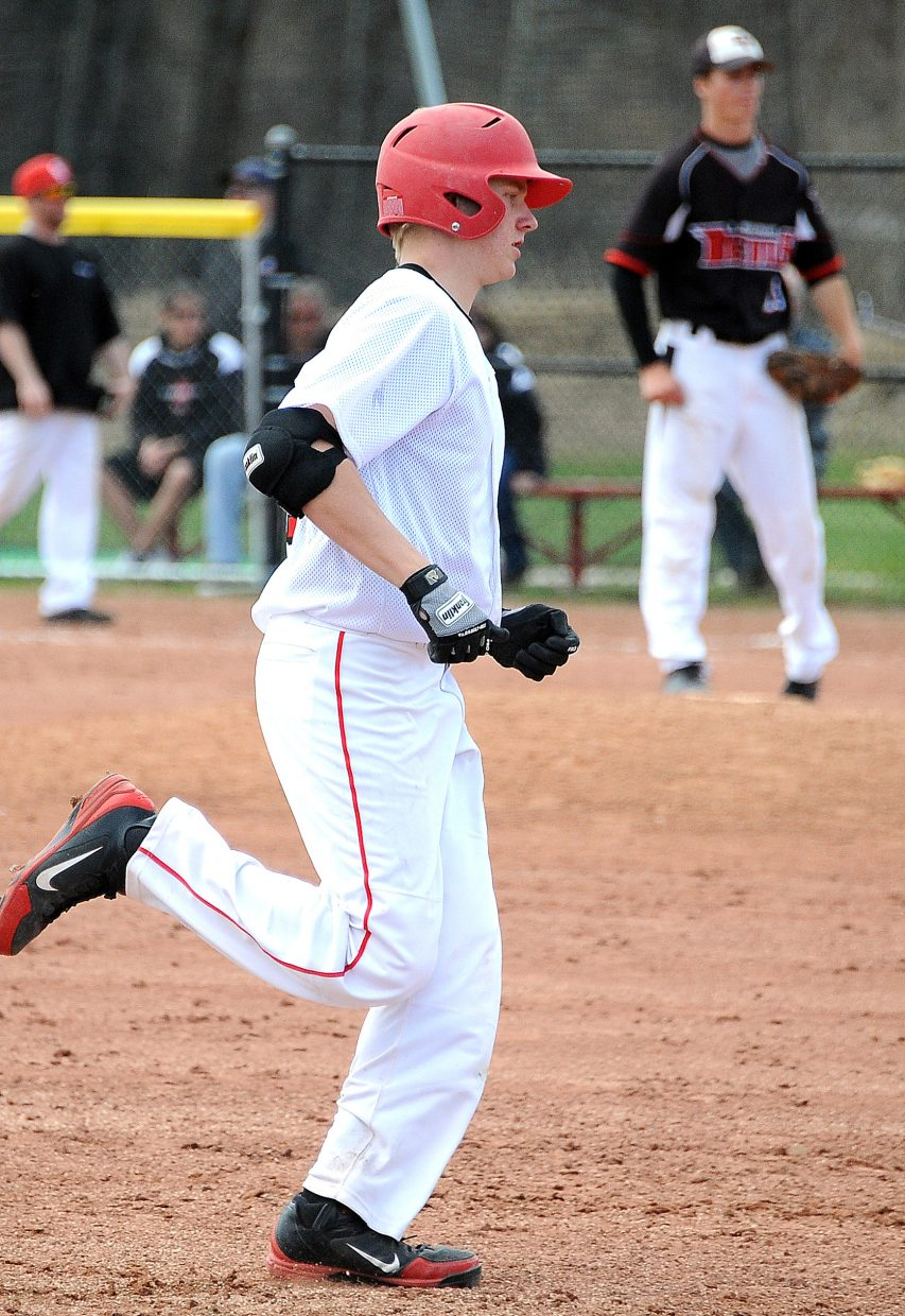 Steamboat's Thomas Kelly rounds the bases after hitting a three-run home run during the first game of Saturday's high school double header in Steamboat.