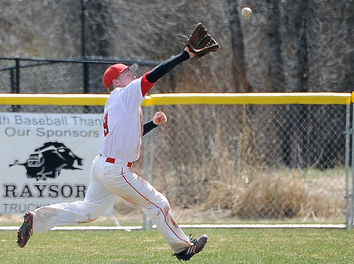 Tommy Lyon hauls in a catch while playing centerfield Saturday for the Steamboat Springs High School baseball team.