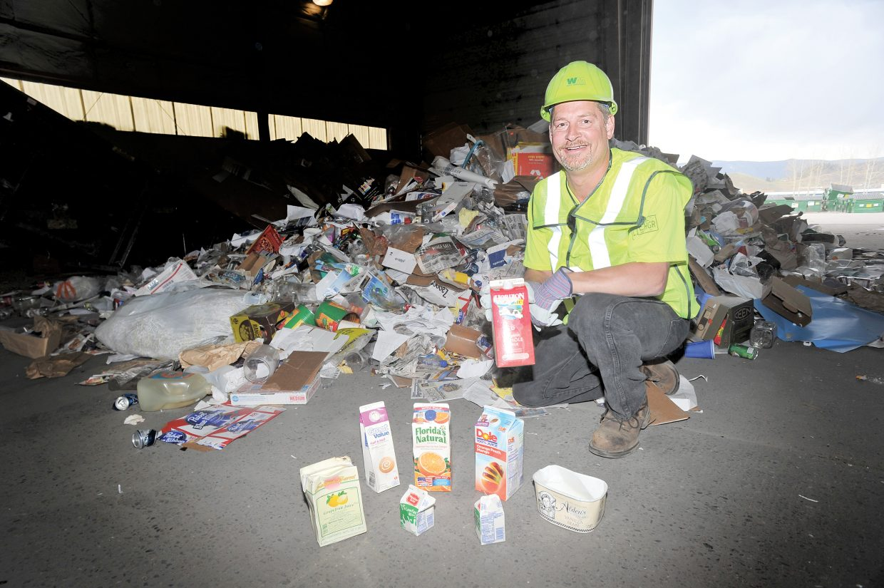 Steve Johnson, district operations manager for Waste Management, shows just a few of the items that now can be recycled in Steamboat Springs.