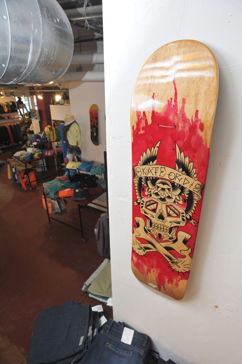 This skate deck created by Melissa Chavarria hangs on the wall of Urbane as part of the fourth annual Skate Deck Art Show. This year's show, which includes 63 decks, will be on display through next week.