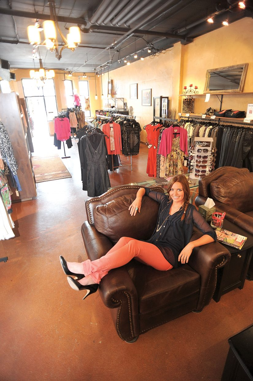 Nicole Regalbuto, an employee with White Pepper, shows off some of the latest fashions at the downtown Steamboat Springs store.
