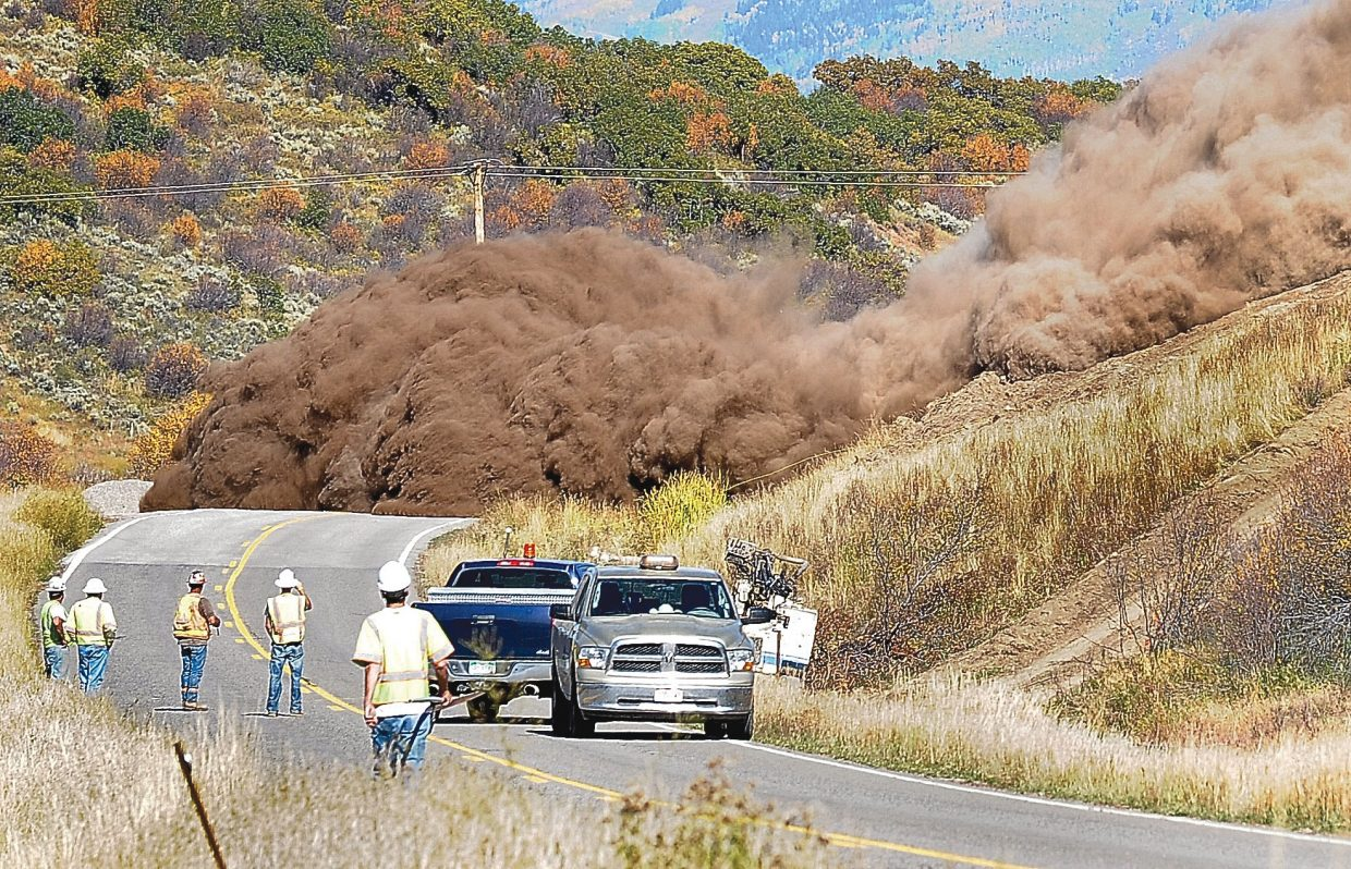 A wall of dirt and rock comes tumbling down a hillside on Colorado Highway 131 in between Steamboat Springs and Oak Creek. The Colorado Department of Transportation was widening and improving a three-mile stretch of highway in Oak Creek Canyon.